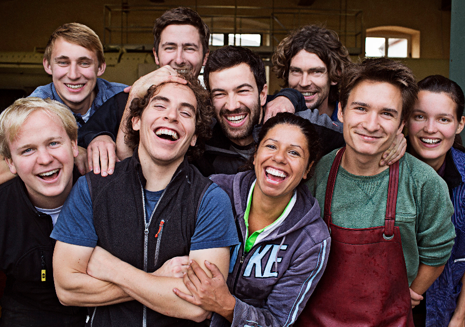 A group of young german winemakers smiling and laughing at the camera
